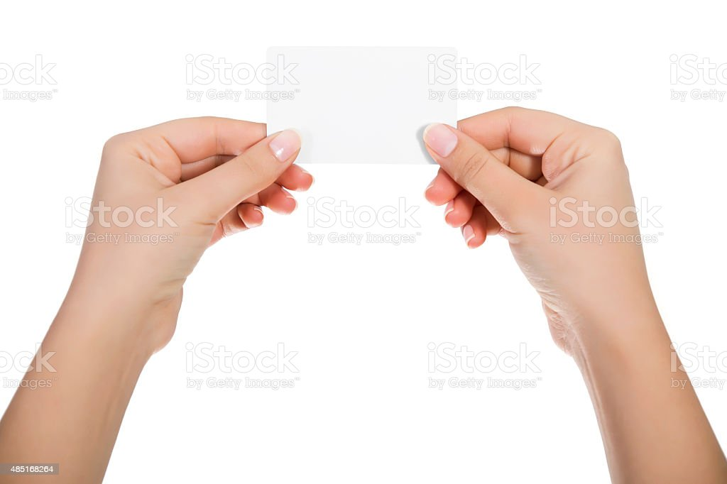 Business card in woman hand on white stock photo