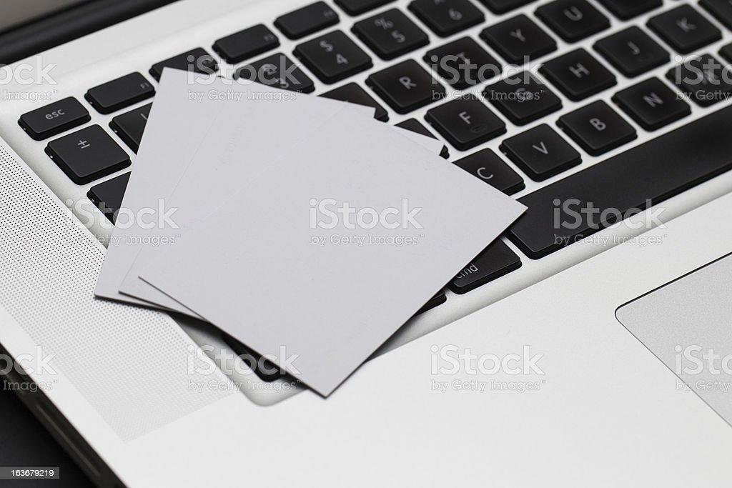 Business cards spread on computer keybaord royalty-free stock photo