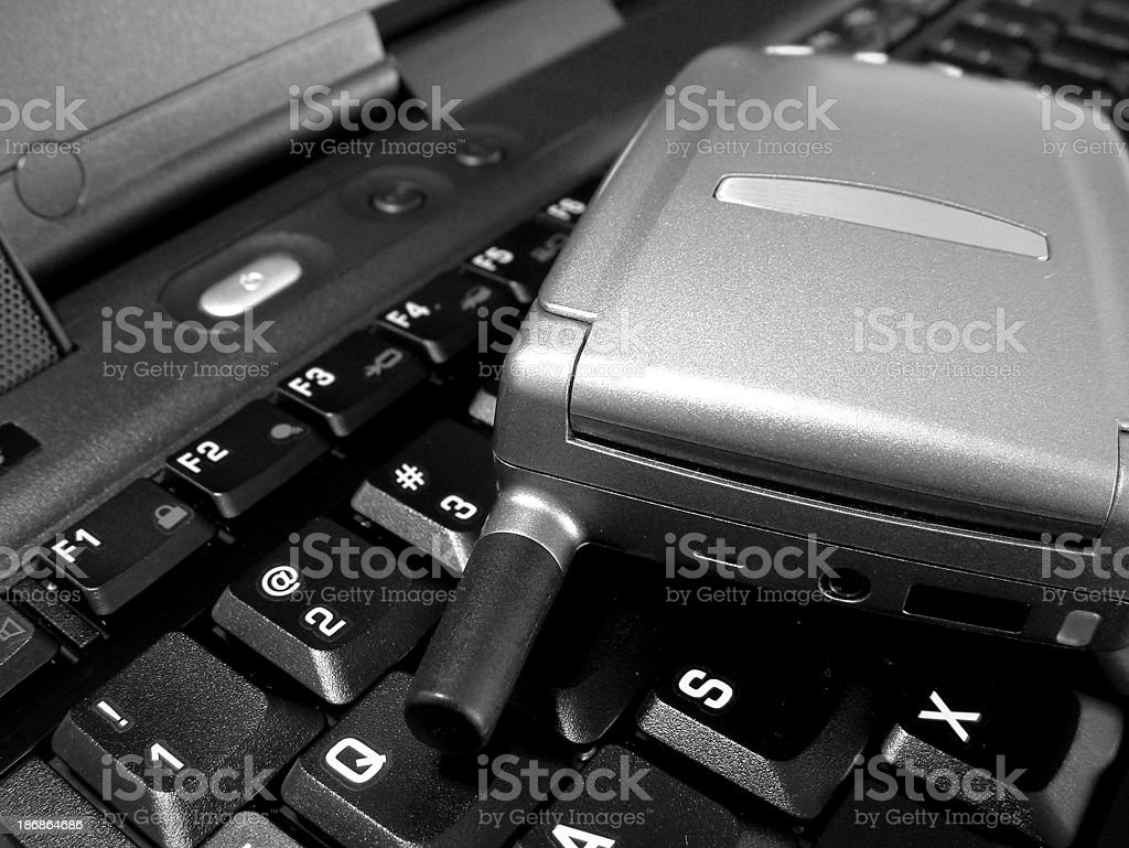 business - cell phone and laptop keyboard royalty-free stock photo