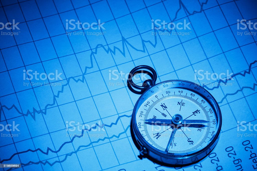 Business chart and compass stock photo