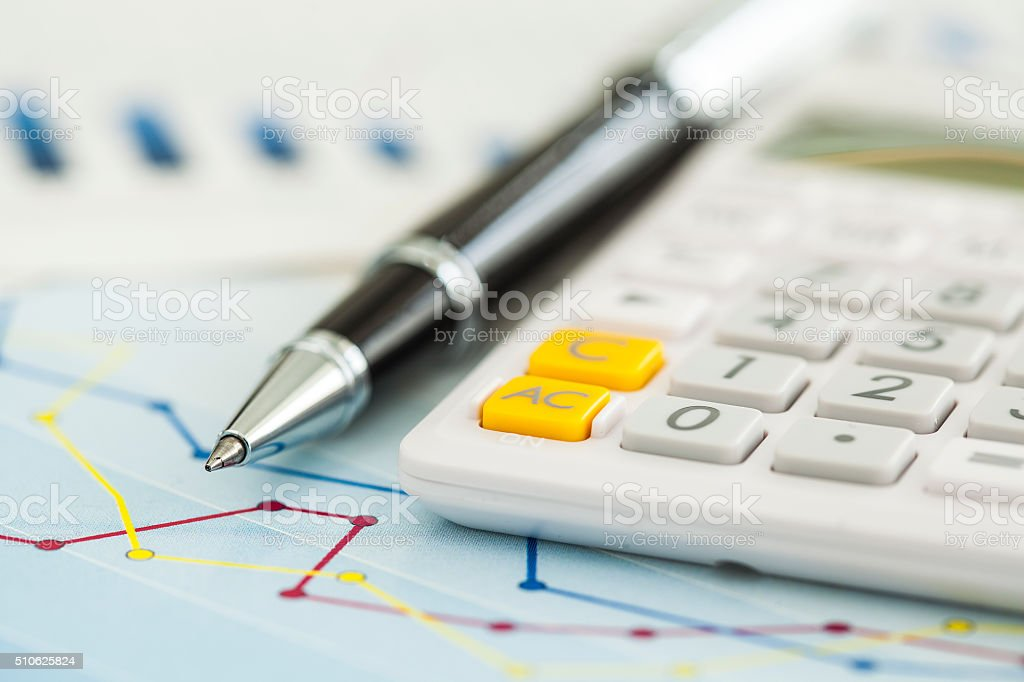 Business charts and calculator stock photo