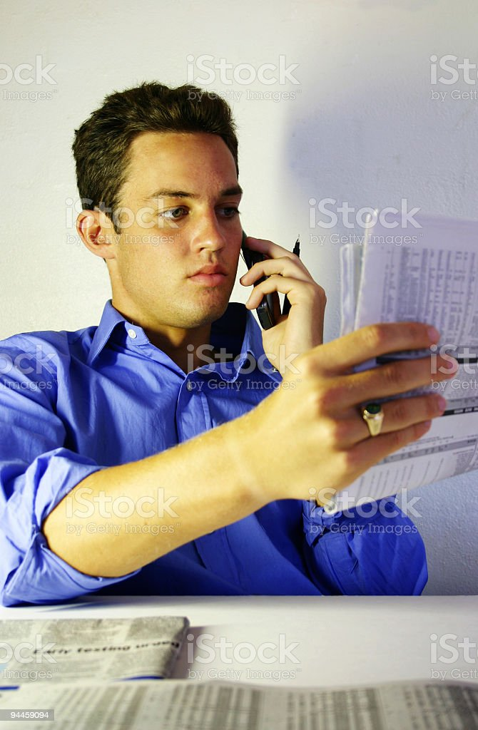 Business - Chatting while reading paper royalty-free stock photo