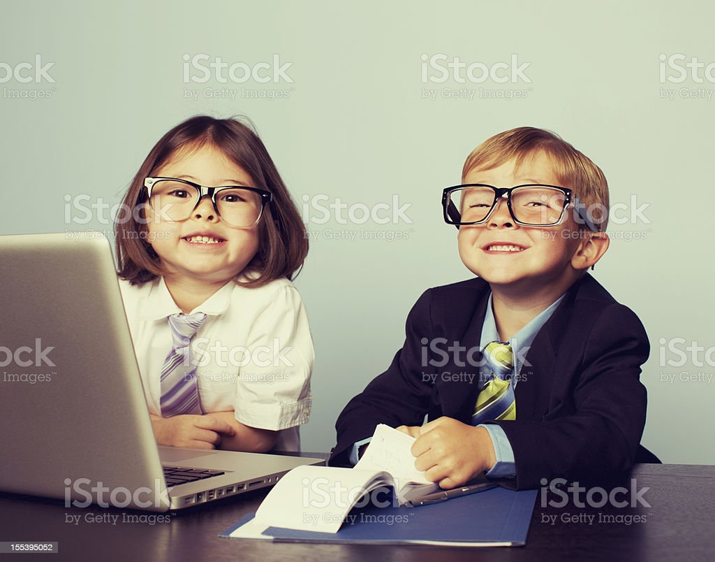 Business Children at Laptop in Office stock photo