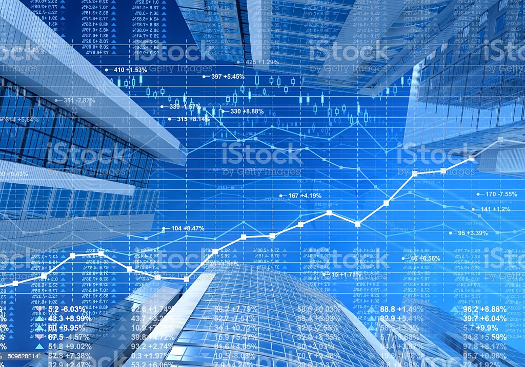 Business city: stock market data and finance charts on skyscrapers stock photo