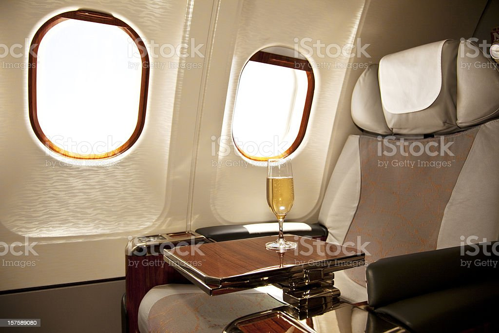 A business class seat on an airplane stock photo