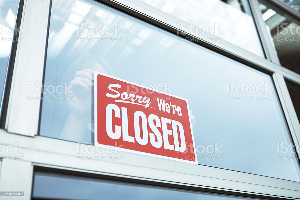 Business Closing with 'Sorry We're Closed' Sign Hz stock photo
