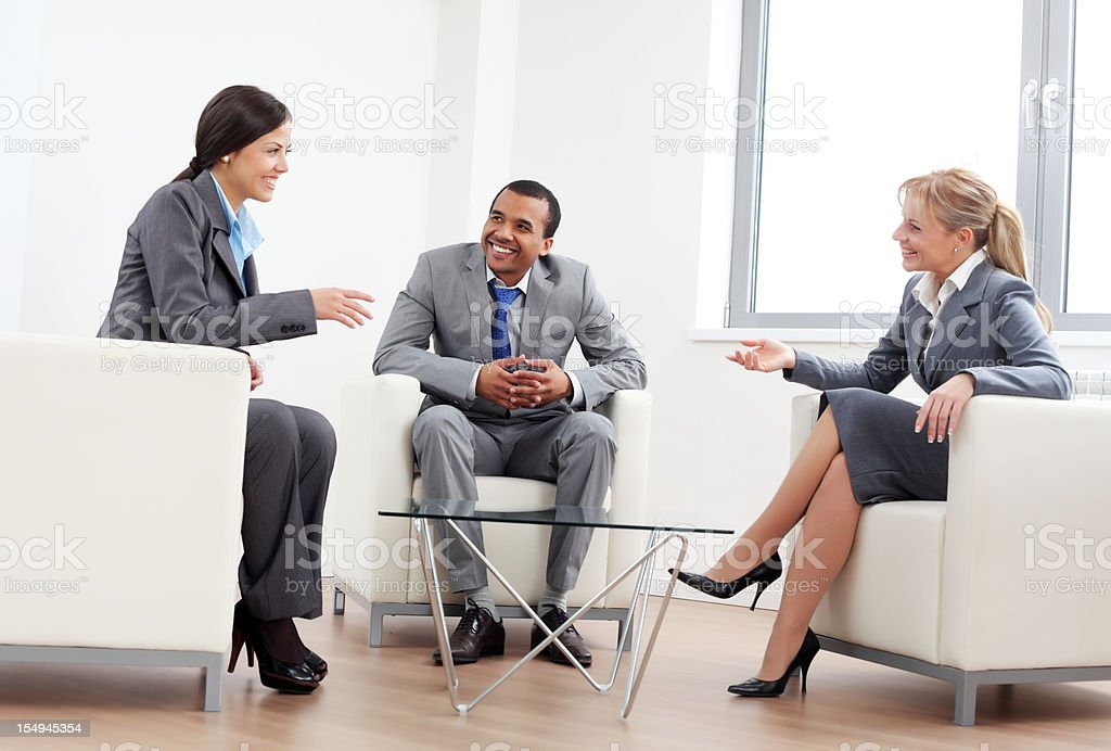 Business colleagues are sitting at the workplace and discussing. royalty-free stock photo