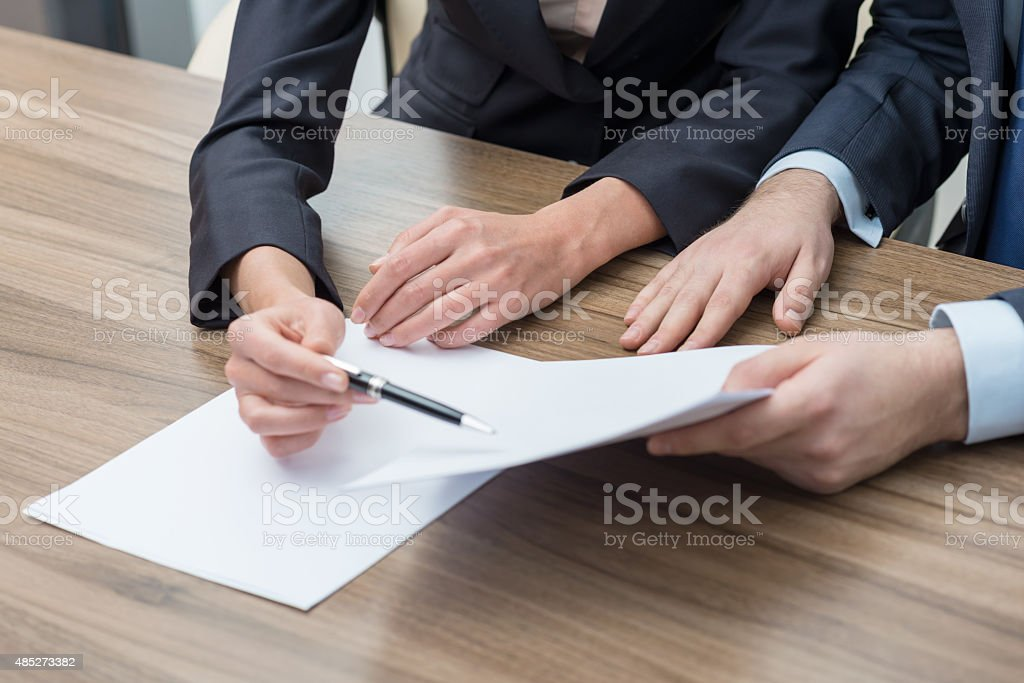 Business colleagues are working on the papers. Toning filter. stock photo