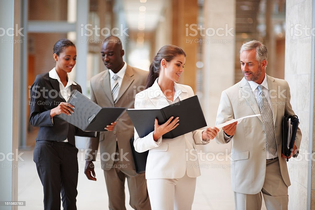 Business colleagues discussing documents in hands royalty-free stock photo