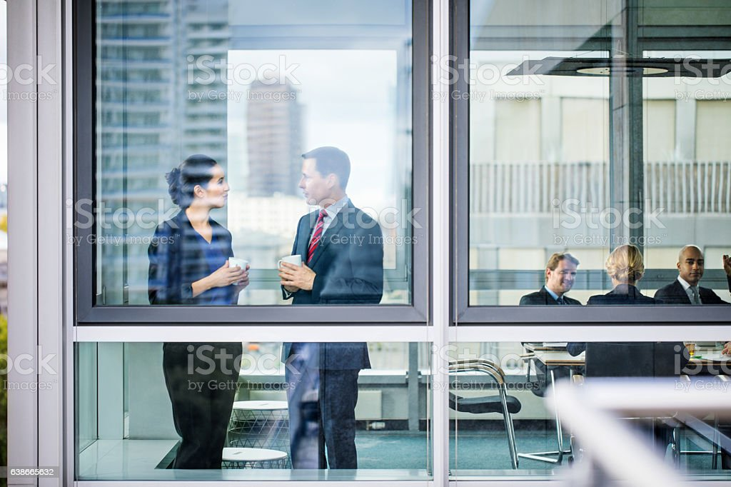 Business colleagues discussing during coffee break stock photo