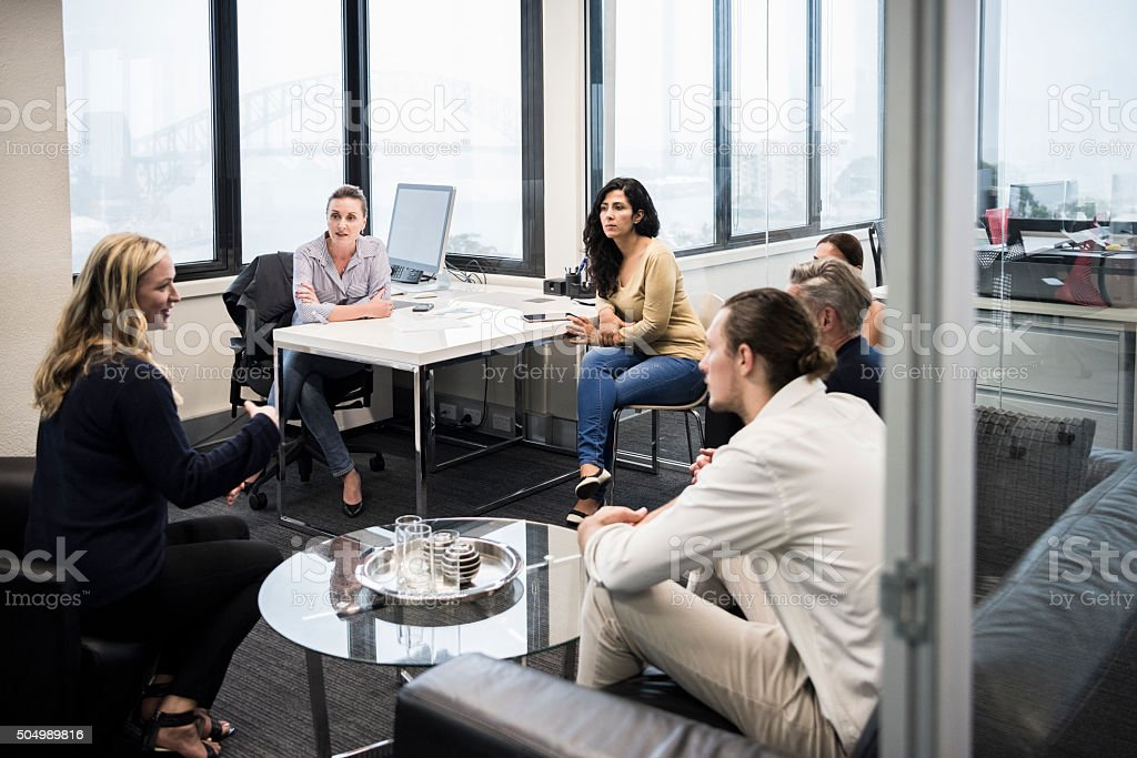 Business colleagues discussing in meeting in modern office stock photo