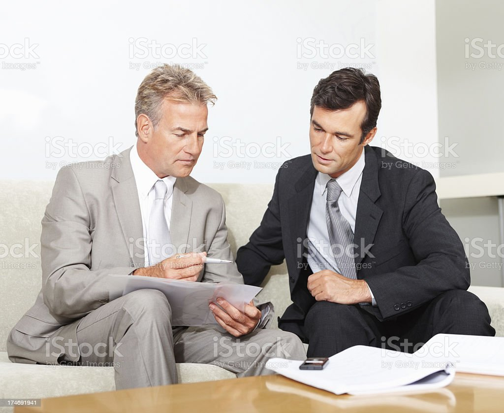 Business colleagues discussing in office royalty-free stock photo