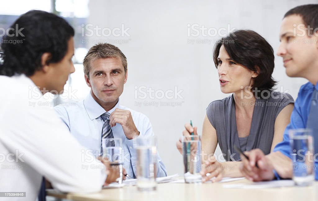 Business colleagues discussing project royalty-free stock photo