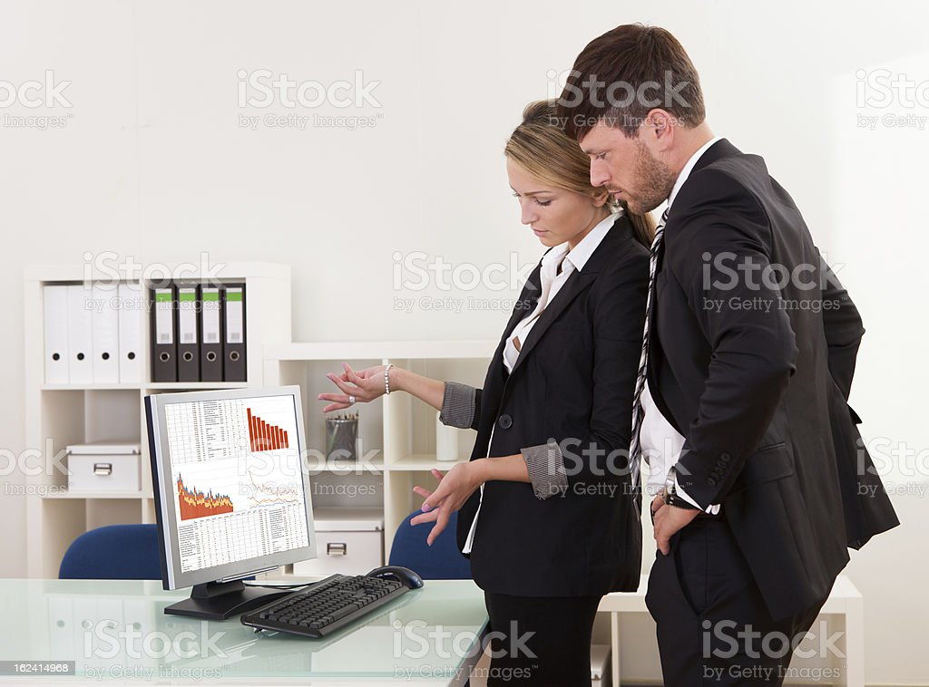 Business colleagues discussing statistics royalty-free stock photo