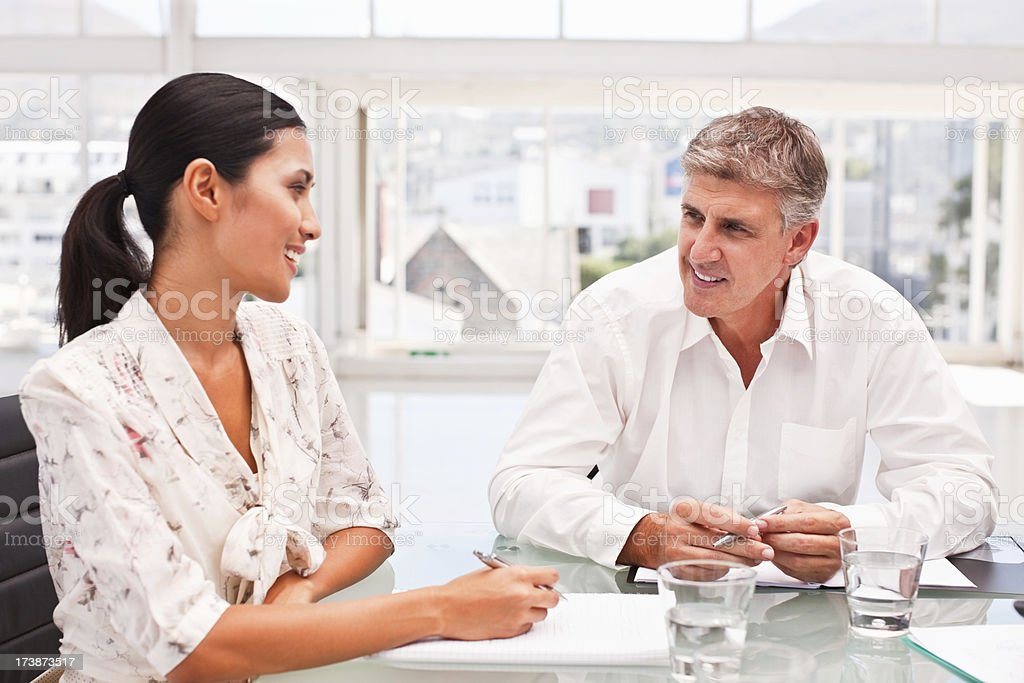 Business colleagues discussing together in office royalty-free stock photo