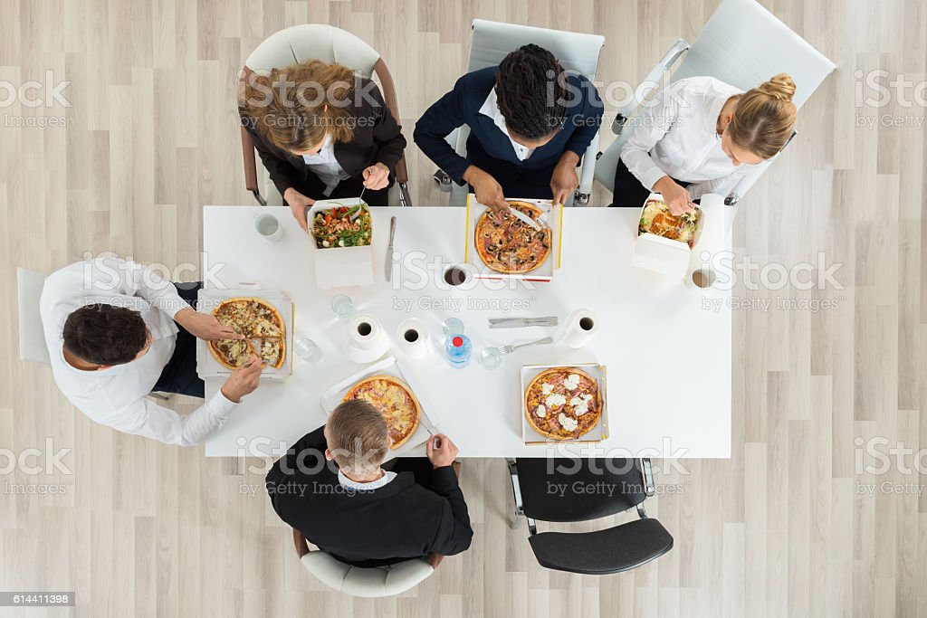 Business Colleagues Eating Food stock photo