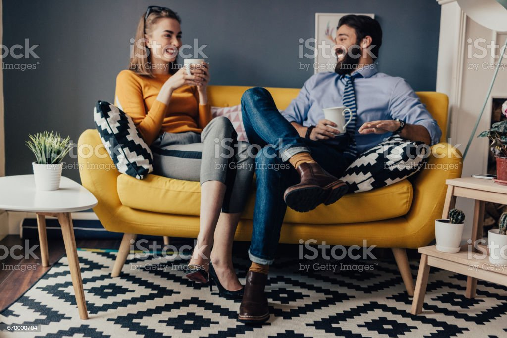 Business colleagues enjoying free time in office break room