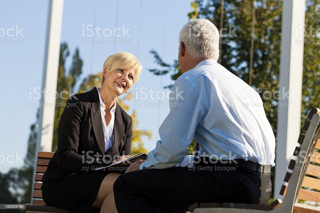 Business colleagues having a coaching session outdoors royalty-free stock photo