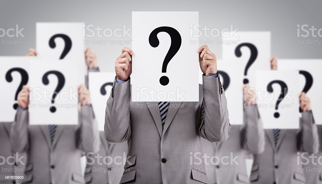 Business colleagues holding question mark signs stock photo