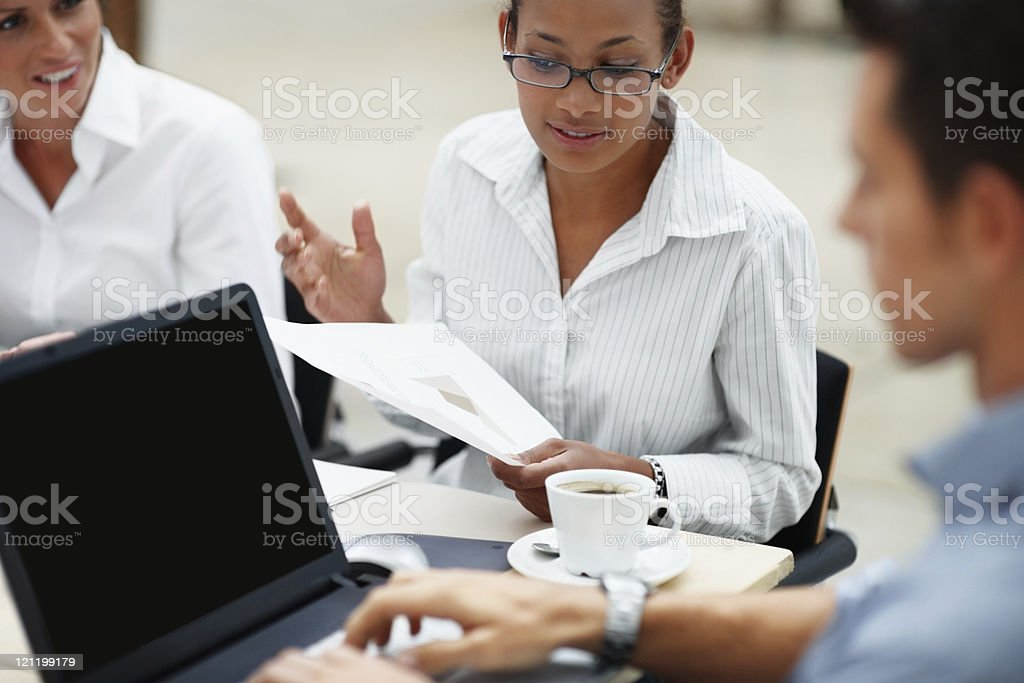 Business colleagues in a discussion while at work royalty-free stock photo