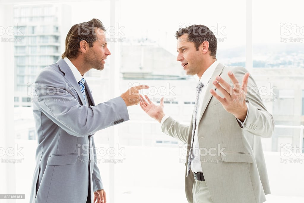 Business colleagues in argument at office stock photo