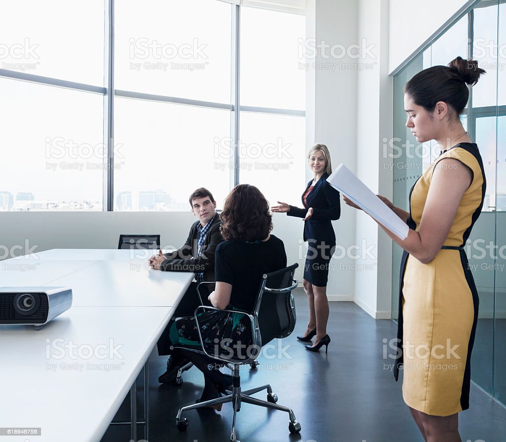 Business colleagues in meeting in conference room stock photo