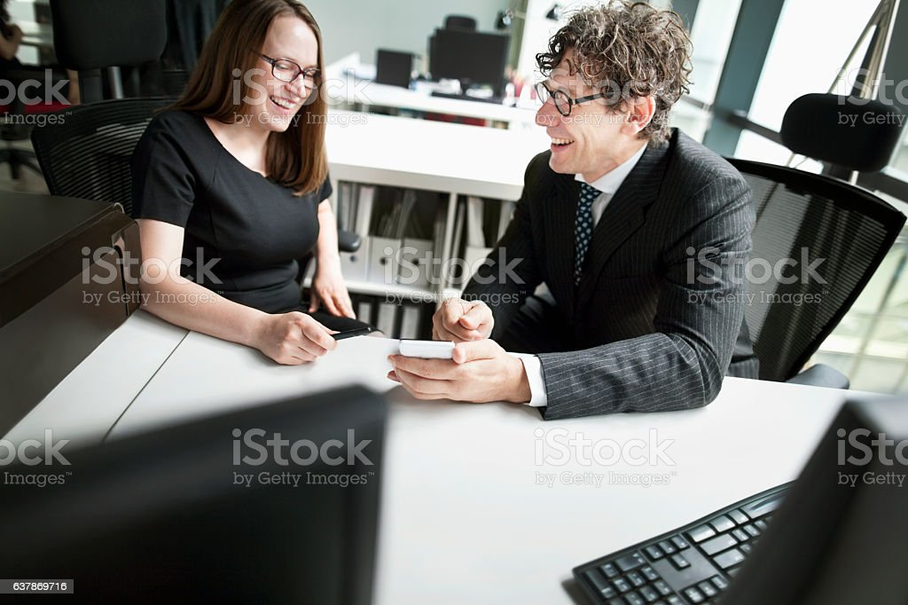 Business colleagues laughing together in design office stock photo
