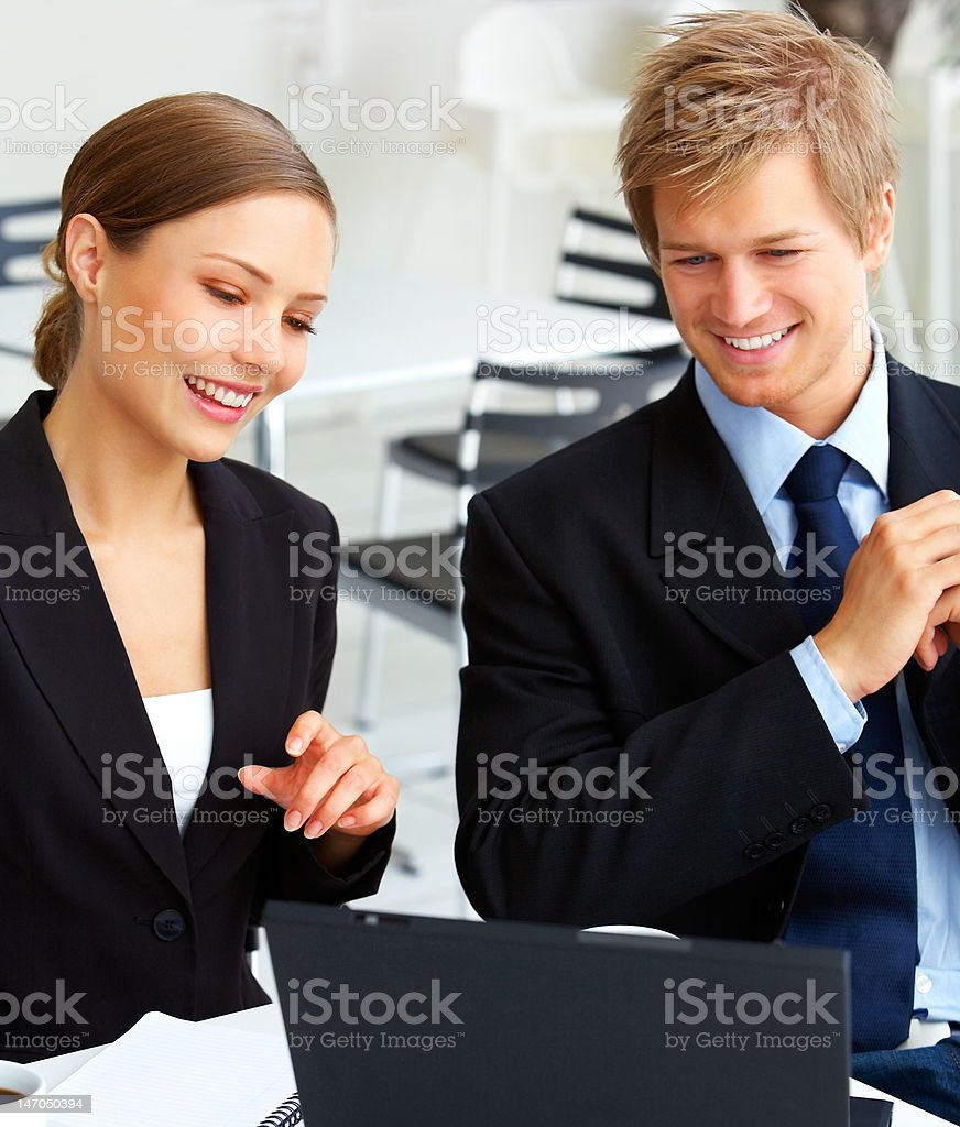 Business colleagues looking at laptop royalty-free stock photo