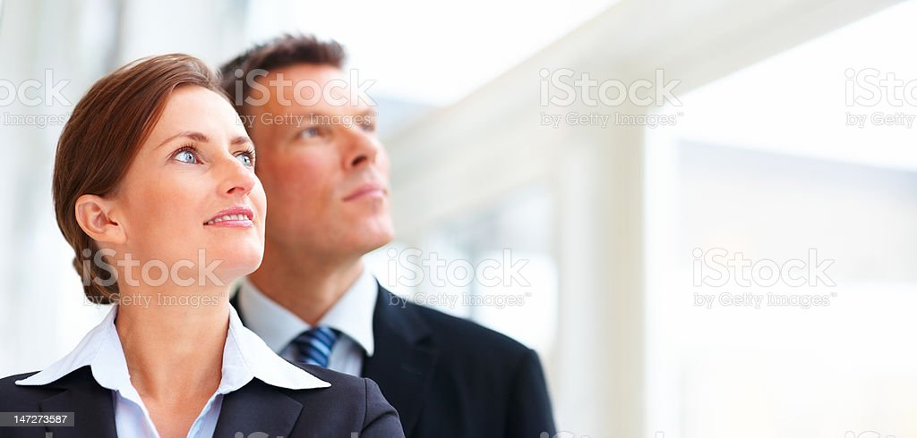 Business colleagues looking away in the office royalty-free stock photo