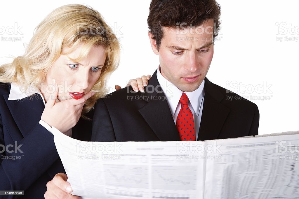 Business colleagues reading newspaper royalty-free stock photo