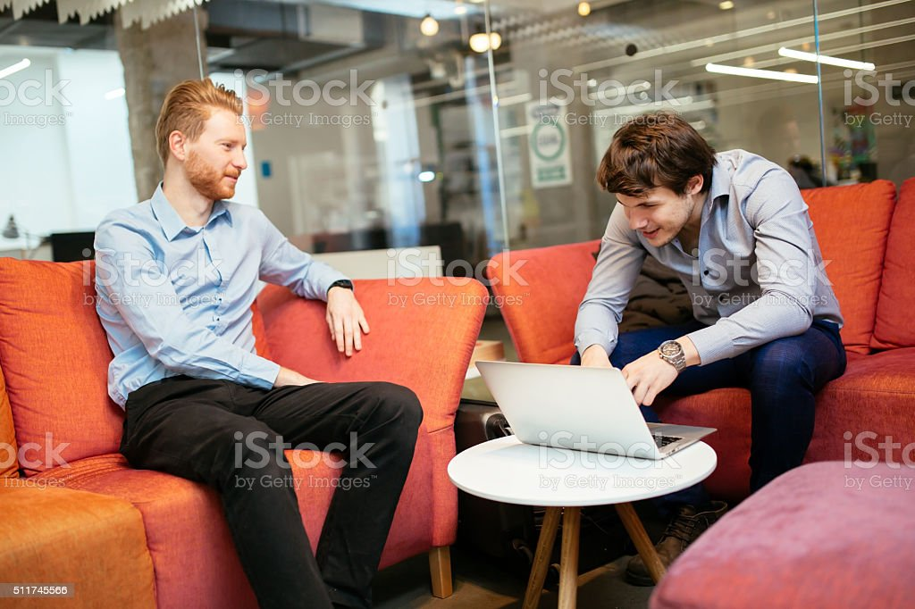Business colleagues resting during break stock photo