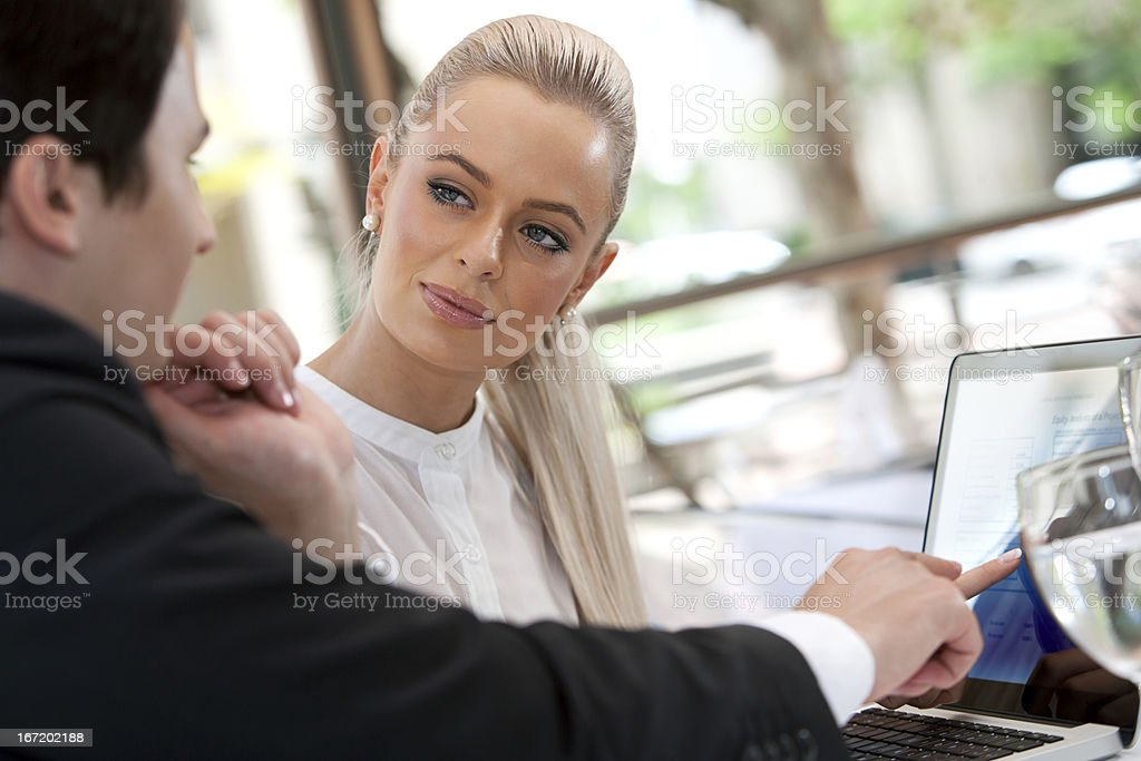 Business colleagues reviewing project at lunch. royalty-free stock photo