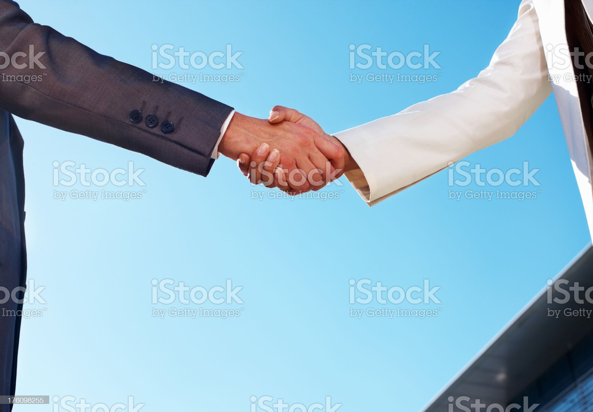 Business colleagues shaking hands royalty-free stock photo