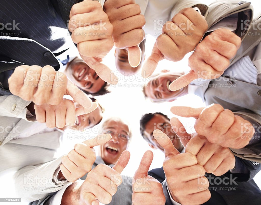 Business colleagues showing thumbs up sign royalty-free stock photo