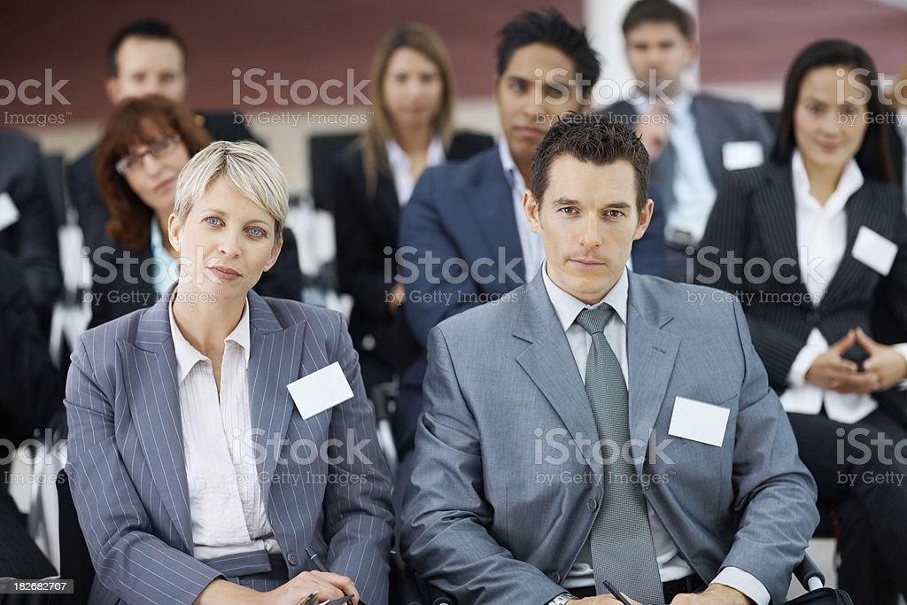 Business colleagues sitting together at a seminar royalty-free stock photo