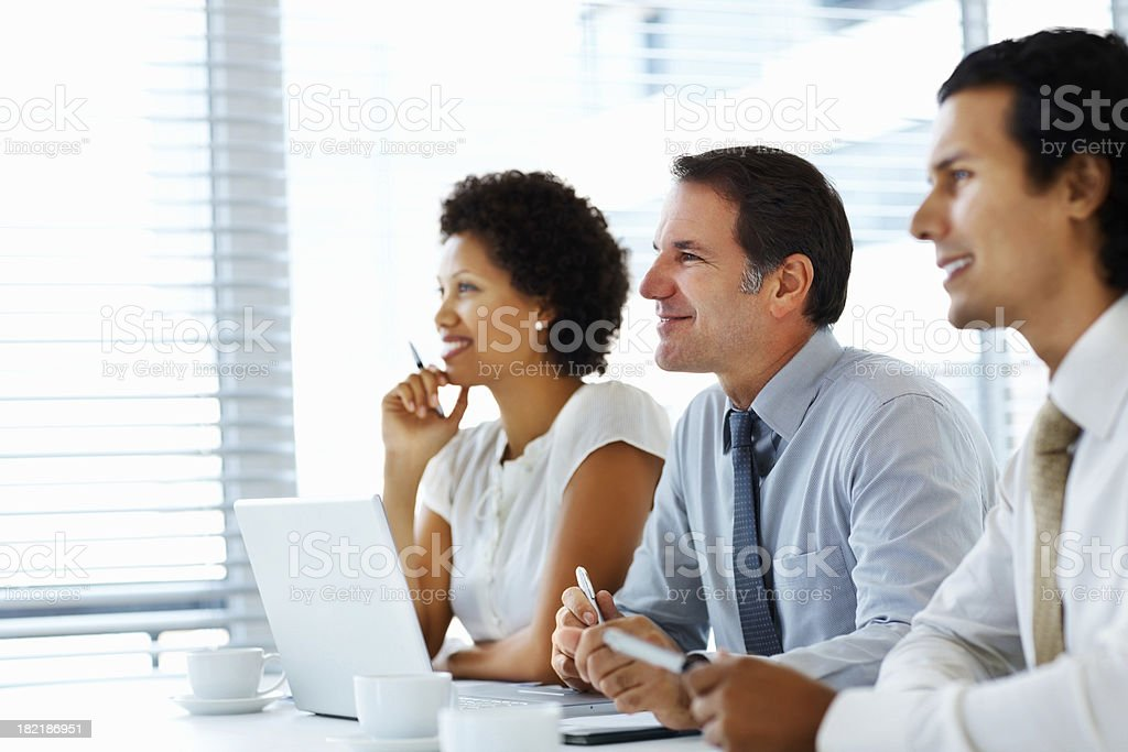Business colleagues smiling during a meeting royalty-free stock photo
