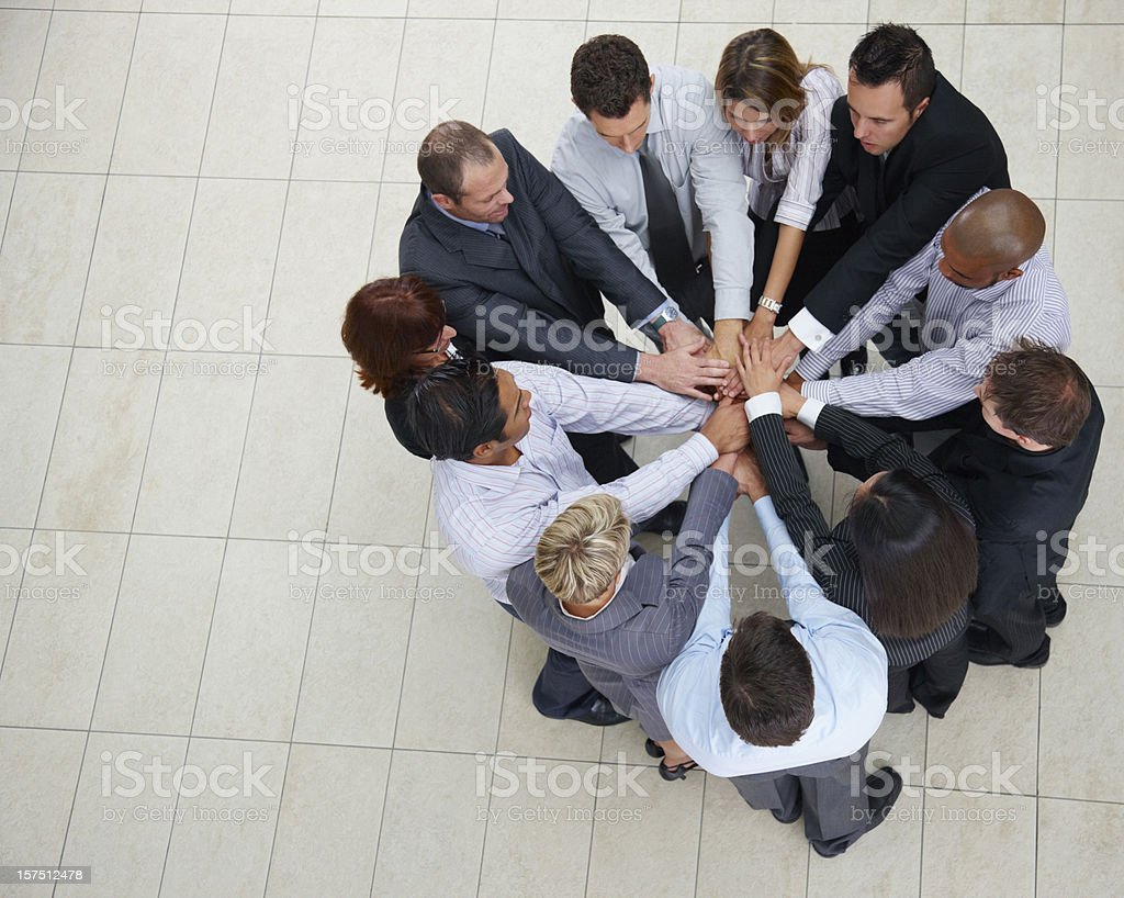 Business colleagues stacking their hands together royalty-free stock photo