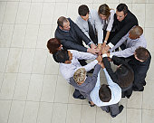 Business colleagues stacking their hands together