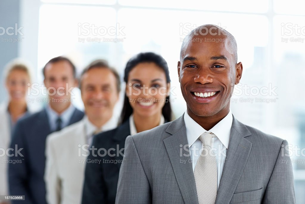 Business colleagues standing in a row and smiling royalty-free stock photo