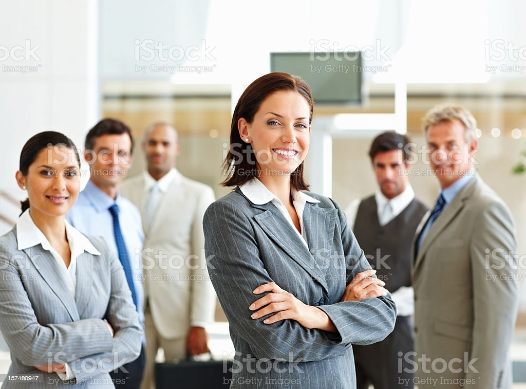Business colleagues standing in office royalty-free stock photo