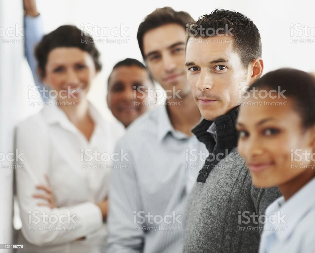 Business colleagues standing together in a line stock photo