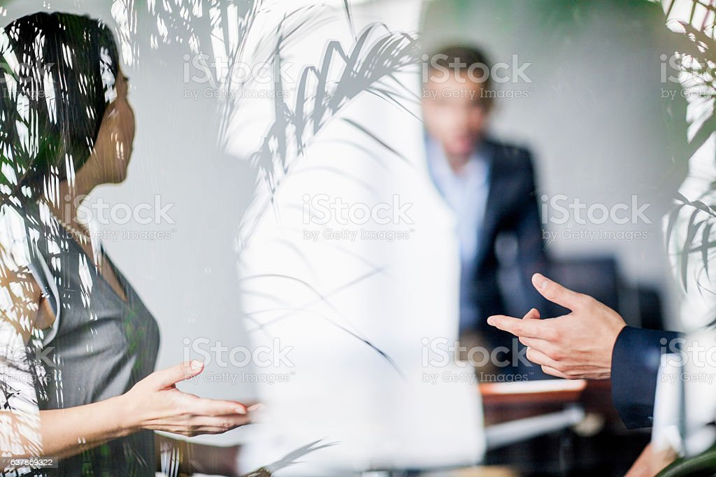 Business colleagues talking in office meeting stock photo
