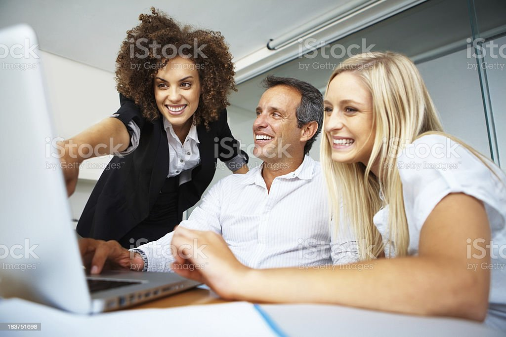 Business colleagues with laptop royalty-free stock photo