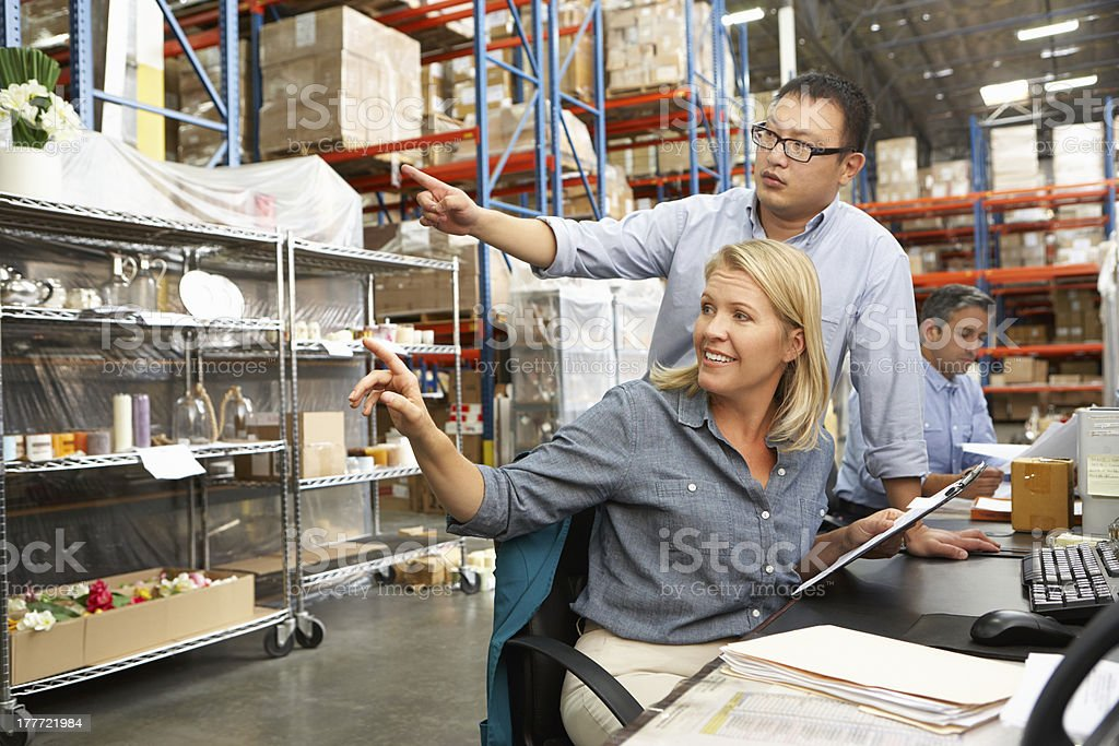 Business colleagues working in a warehouse stock photo