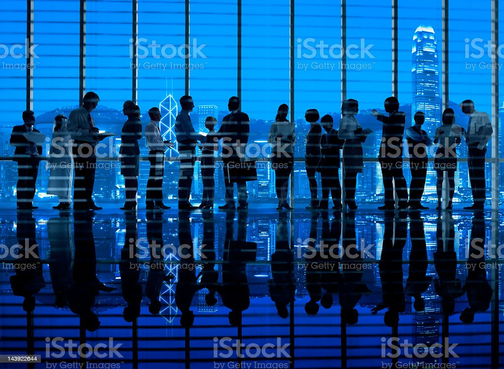 Business colleagues working in Hong Kong office stock photo