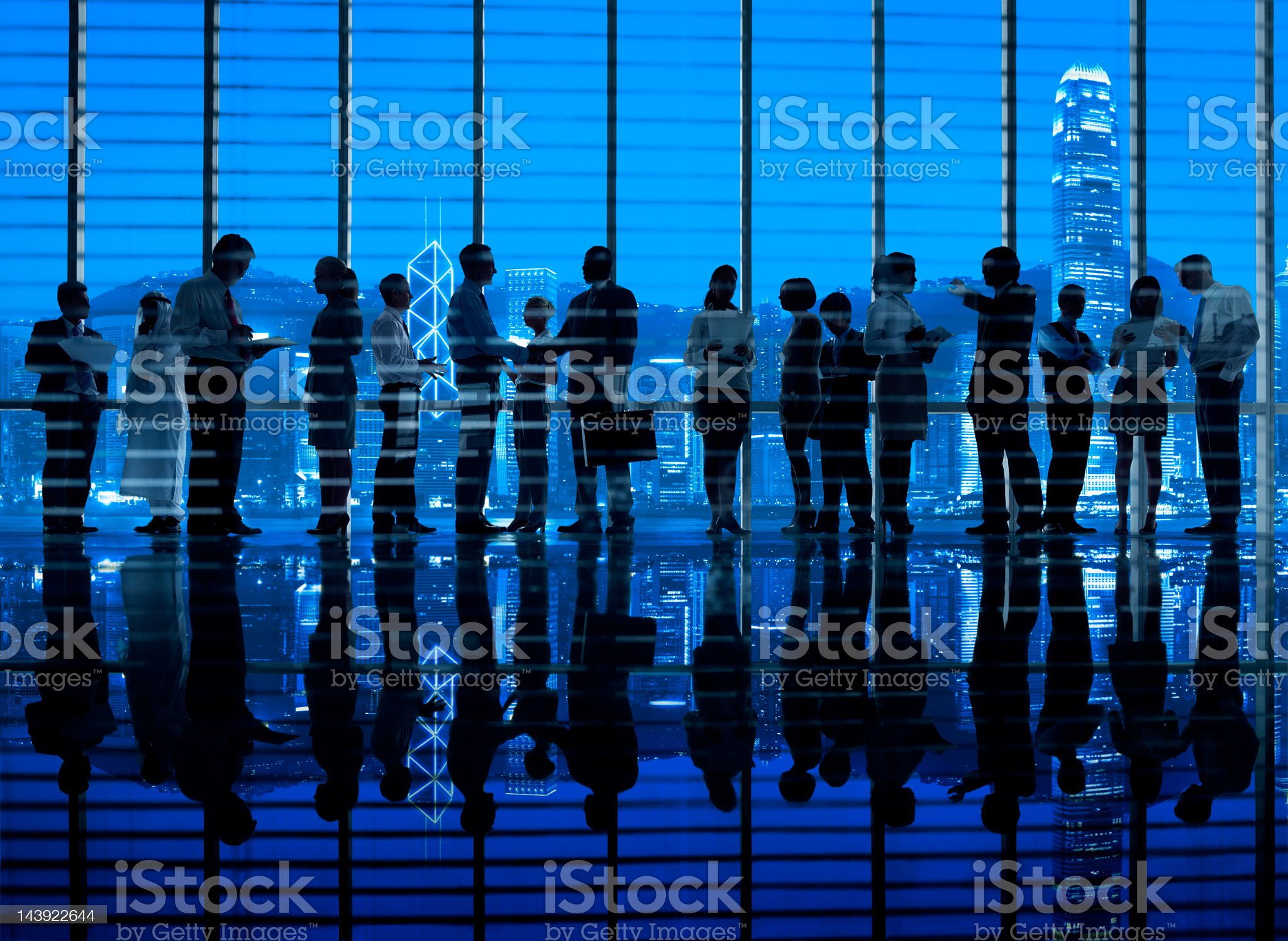 Business colleagues working in Hong Kong office royalty-free stock photo