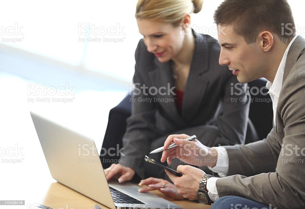 Business colleagues working on a laptop. royalty-free stock photo