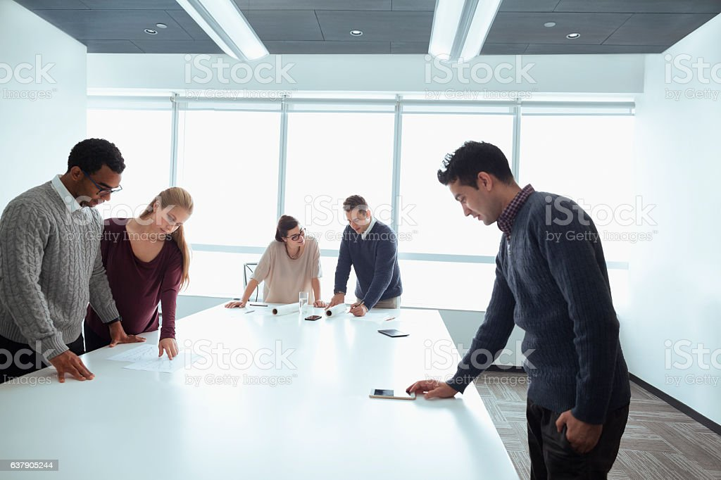 Business colleagues working together in meeting room stock photo