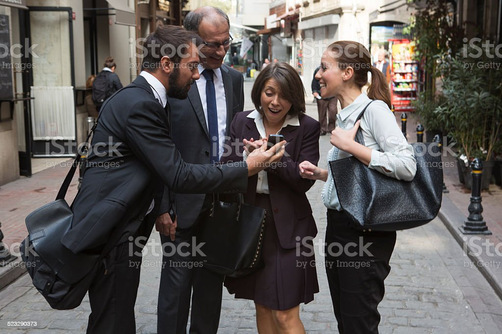 business colleges sharing photo on phone in istanbul turkey stock photo
