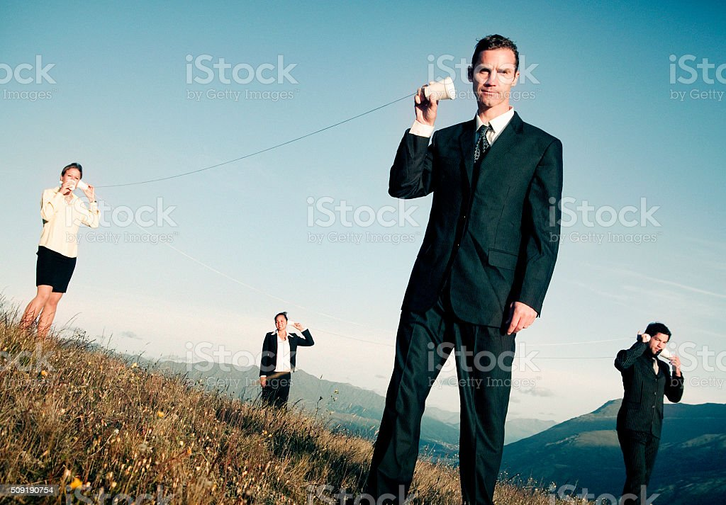 Business Communicate Through Paper Cup Phone Outdoors Concept stock photo
